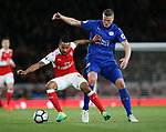 Arsenal's Theo Walcott tussles with Leicester's Robert Huth during the Premier League match at the Emirates Stadium, London. Picture date: April 26th, 2017. Pic credit should read: David Klein/Sportimage