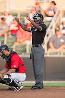 Home plate umpire Darrell Roberts signals the count during the South Atlantic League game between the Hagerstown Suns and the Kannapolis Intimidators at Kannapolis Intimidators Stadium on July 4, 2016 in Kannapolis, North Carolina.  The Intimidators defeated the Suns 8-2.  (Brian Westerholt/Four Seam Images)