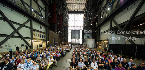In this photo released by the National Aeronautics and Space Administration (NASA) United States Vice President Mike Pence, as seen on the monitor at right, addresses NASA employees, Thursday, July 6, 2017, at the Vehicle Assembly Building at NASA&rsquo;s Kennedy Space Center (KSC) in Cape Canaveral, Florida. The Vice President thanked employees for advancing American leadership in space, before going on a tour of the center that highlighted the public-private partnerships at KSC, as both NASA and commercial companies prepare to launch American astronauts from the multi-user spaceport.  <br /> Mandatory Credit: Aubrey Gemignani / NASA via CNP