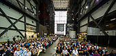 In this photo released by the National Aeronautics and Space Administration (NASA) United States Vice President Mike Pence, as seen on the monitor at right, addresses NASA employees, Thursday, July 6, 2017, at the Vehicle Assembly Building at NASA's Kennedy Space Center (KSC) in Cape Canaveral, Florida. The Vice President thanked employees for advancing American leadership in space, before going on a tour of the center that highlighted the public-private partnerships at KSC, as both NASA and commercial companies prepare to launch American astronauts from the multi-user spaceport.  <br /> Mandatory Credit: Aubrey Gemignani / NASA via CNP