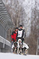 Saturday March 6 , 2010   Sven Haltman and team run across the bridge over Northern Lights Blvd during the ceremonial start of the 2010 Iditarod in Anchorage , Alaska