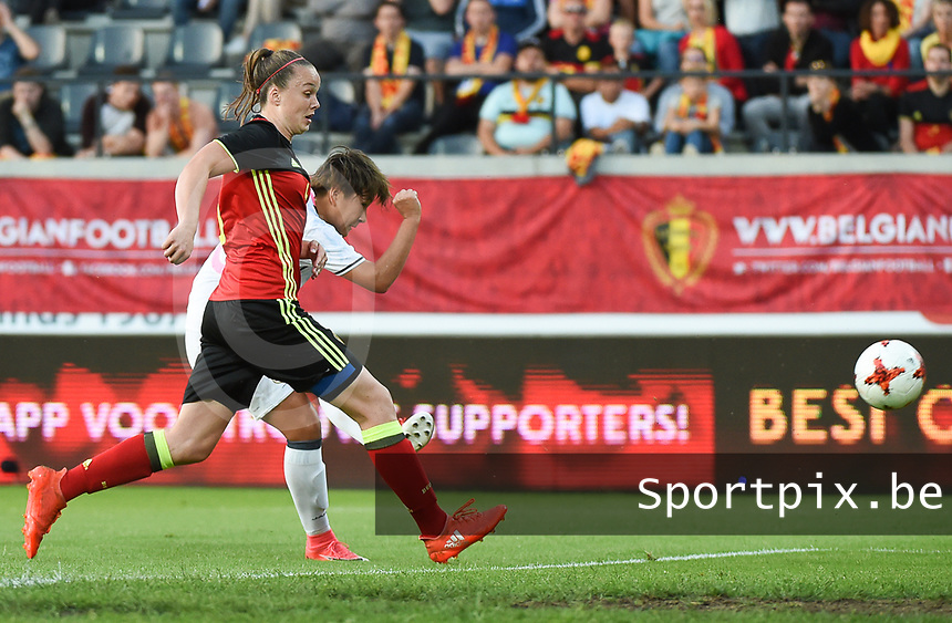 20170613 - LEUVEN ,  BELGIUM : Belgian Tine De Caigny (L) and Japanese Yuka Momiki (L) who scores the openinggoal for Japan  pictured during the female soccer game between the Belgian Red Flames and Japan , a friendly game before the European Championship in The Netherlands 2017  , Tuesday 13 th Juin 2017 at Stadion Den Dreef  in Leuven , Belgium. PHOTO SPORTPIX.BE | DIRK VUYLSTEKE