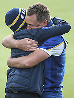 Ian Poulter (Team Europe) hugs his son during Sunday's Singles, at the Ryder Cup, Le Golf National, Île-de-France, France. 30/09/2018.<br /> Picture David Lloyd / Golffile.ie<br /> <br /> All photo usage must carry mandatory copyright credit (© Golffile | David Lloyd)