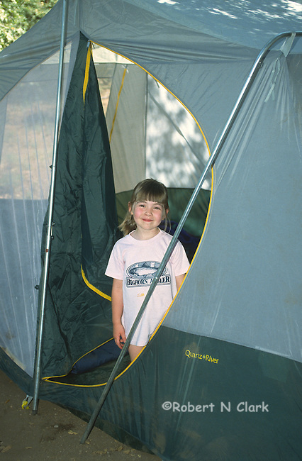 Girl in tent entrance