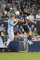 Seth Sinovic, Sporting KC, Kelyn Rowe New England go up for a header... Sporting Kansas City defeated New England Revolution 3-0 at LIVESTRONG Sporting Park, Kansas City, Kansas.