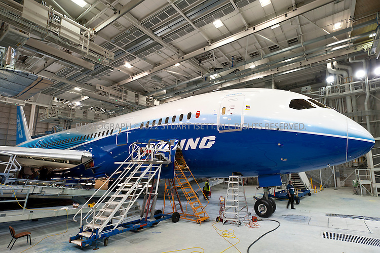 4/30/2009--Everett, WA, USA...At Boeing's Everett, Wash., the first Boeing 787 under production that will be used in the first test flights that Boeing expects in the second quarter of 2009...The 787-8 Dreamliner will carry 210 - 250 passengers on routes of 7,650 to 8,200 nautical miles (14,200 to 15,200 kilometers), while the 787-9 Dreamliner will carry 250 - 290 passengers on routes of 8,000 to 8,500 nautical miles (14,800 to 15,750 kilometers).  A third 787 family member, the 787-3 Dreamliner, will accommodate 290 - 330 passengers and be optimized for routes of 2,500 to 3,050 nautical miles (4,600 to 5,650 kilometers). ..In addition to bringing big-jet ranges to mid-size airplanes, the 787 will provide airlines with unmatched fuel efficiency, resulting in exceptional environmental performance. The airplane will use 20 percent less fuel for comparable missions than today's similarly sized airplane. It will also travel at speeds similar to today's fastest wide bodies, Mach 0.85. Airlines will enjoy more cargo revenue capacity. Passengers will also see improvements with the new air..Photograph ©2009 Stuart Isett.All rights reserved