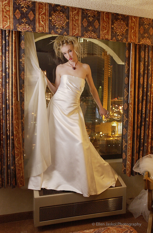 Nicole, a Las Vegas model, poses in a wedding gown in a room at the Excalibur Hotel and Casino in Las Vegas for a bridal fashion shoot on January 31, 2004.
