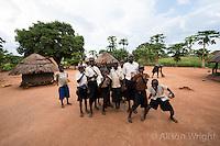 N. Uganda, Gwendiya, Gulu District. Peter C. Alderman Foundation project. Children in front of their round thatched huts.