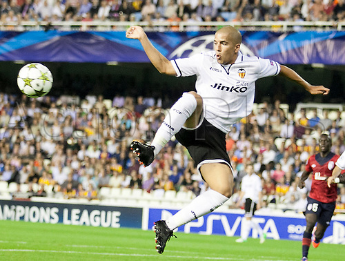 02.10.2012 Valencia, Spain.  Midfielder Sofiane Feghouli of Valencia CF controls a high ball during the Champions League Group G game between Valencia   and Lille from Mestalla, Valencia, Spain.