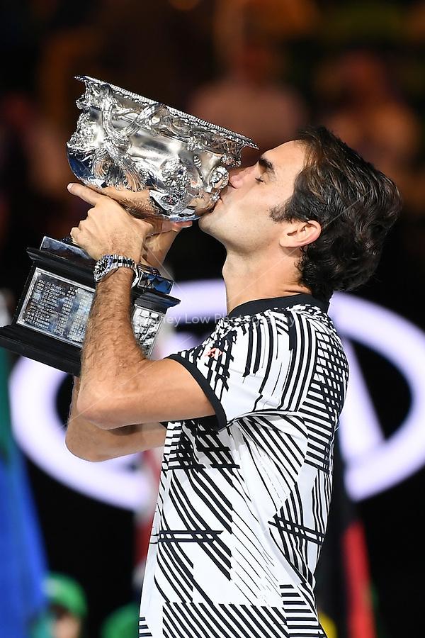 January 29, 2017: Roger Federer of Switzerland kisses the trophy after winning the Men's Final against Rafael Nadal of Spain on day 14 of the 2017 Australian Open Grand Slam tennis tournament in Melbourne, Australia. Photo Sydney Low