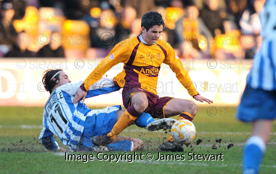 09/02/2008    Copyright Pic: James Stewart.File Name : sct_jspa15_motherwell_v_kilmarnock.DANNY INVINCIBILE CHALLENGES KEITH LASLEY.James Stewart Photo Agency 19 Carronlea Drive, Falkirk. FK2 8DN      Vat Reg No. 607 6932 25.Studio      : +44 (0)1324 611191 .Mobile      : +44 (0)7721 416997.E-mail  :  jim@jspa.co.uk.If you require further information then contact Jim Stewart on any of the numbers above........