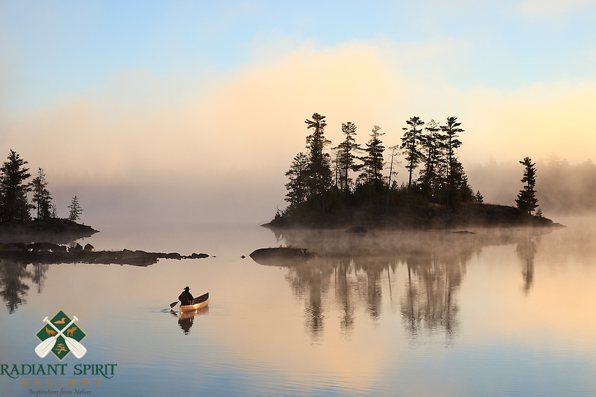 &quot;Paddling to Sunrise&quot;<br /> <br /> The canoeist paddles toward the foggy sunrise in the Boundary Waters Canoe Area Wilderness (BWCAW). The wilderness provides an abundance of solitude and serenity for the soul.