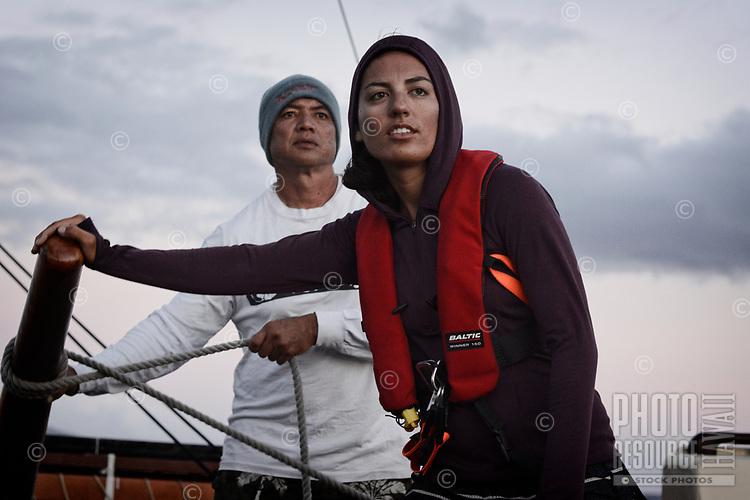 Two crewmembers on a training sail aboard Hikianalia, in Ma'alaea, Maui, June 16, 2013; this was part of a statewide sail with Hokule'a from Hilo, Hawai'i Island, to Honolulu, O'ahu.