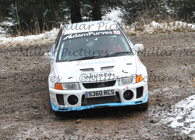 Garry Wilson - Hollie Wilson in a Mitsubishi Lancer Evolution 5 at Junction 6 on Special Stage 1 Riccarton on the Brick & Steel Border Counties Rally 2014, Round 2 of the RAC MSA Scottish Rally Championship sponsored by ARR Craib Transport Limited and other championships  and organised by Whickham & District and Hawick & Border Car Clubs and based in Jedburgh and held in Kielder Forest on 22.3.14.