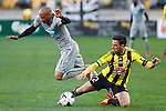 Newcastle United's Yoan Gouffran, left, sails through that air after a tackle from Wellington Phoenix's Manny Muscat, right, in the fourth match of the Football United Tour at Westpac Stadium, Wellington, New Zealand, Saturday, July 26, 2014. Credit: Dean Pemberton