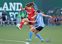 Portland, Oregon - Saturday July 2, 2016: Portland Thorns FC midfielder Meleana Shim (6) passes the ball during a regular season National Women's Soccer League (NWSL) match at Providence Park.