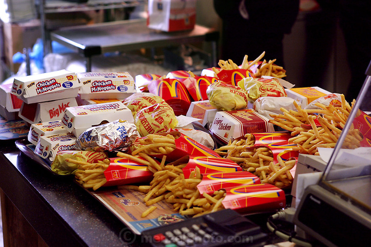 Orders up at McDonald's restaurant in San Antonio, Texas, USA. (From a photographic gallery of images of fast food, in Hungry Planet: What the World Eats, p. 94)