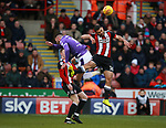 Cameron Carter-Vickers of Sheffield Utd challenges Gary Madine of Bolton Wanderers during the Championship match at Bramall Lane Stadium, Sheffield. Picture date 30th December 2017. Picture credit should read: Simon Bellis/Sportimage