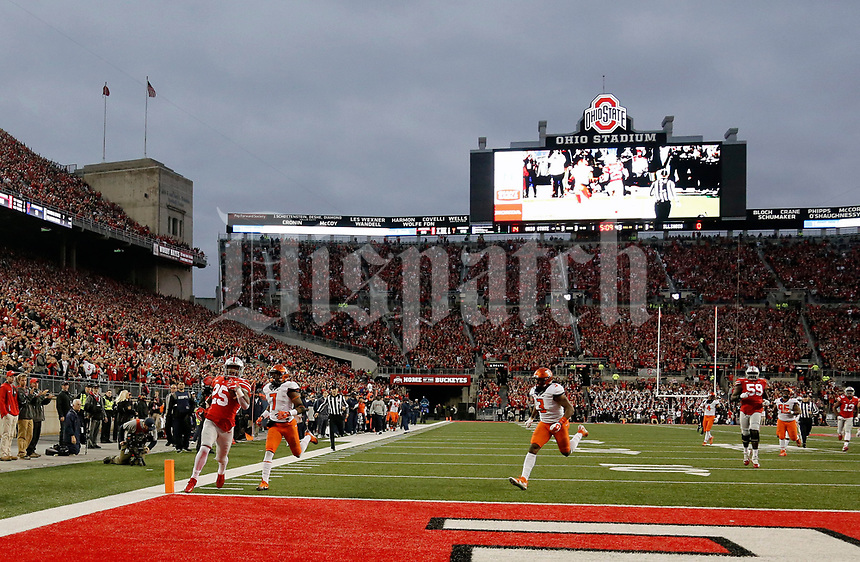 Ohio State Buckeyes running back Mike Weber (25) runs away from Illinois Fighting Illini defensive back Stanley Green (7) on a touchdown run during the 1st half of their game at Ohio Stadium on November 18, 2017.  [Kyle Robertson / Dispatch]