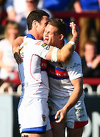 PICTURE BY VAUGHN RIDLEY/SWPIX.COM - Rugby League - Super League - Wakefield Wildcats v Catalans Dragons - Rapid Solicitors Stadium, Wakefield, England - 25/03/12 - Wakefield's Peter fox celebrates his second try with Richie Mathers.