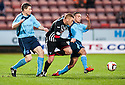 Pars' Robert Thomson tries to get past Forfar's Darren Dods and James Dale.
