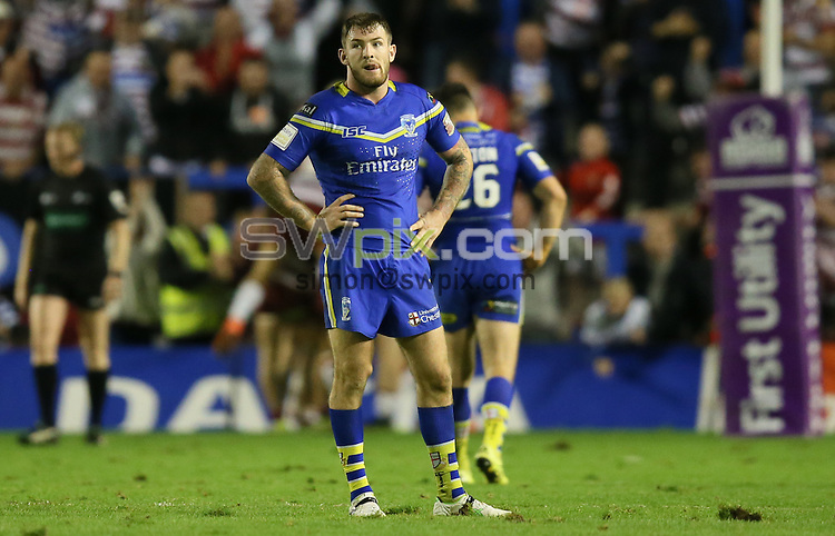 Picture by Paul Currie/SWpix.com - 16/09/2016 - Rugby League - First Utility Super League - Warrington Wolves v Wigan Warriors - Halliwell Jones Stadium, Warrington, England - Warrington Wolves' Daryl Clark dejected after the 6th try