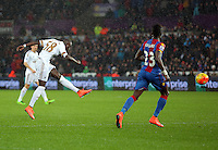 Modou Barrow of Swansea takes a shot off target during the Barclays Premier League match between Swansea City and Crystal Palace at the Liberty Stadium, Swansea on February 06 2016