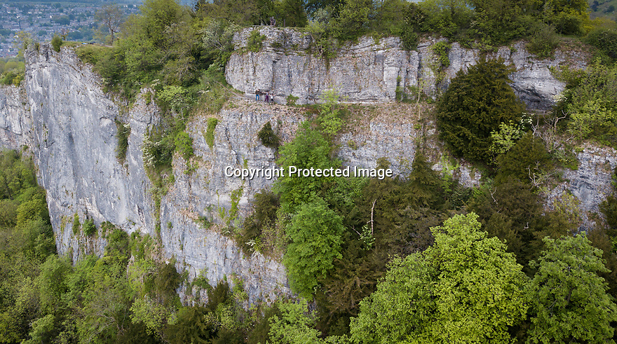 19/05/19<br /> <br /> ***With video***<br /> <br /> Where eagles dare - a family brave a walk along what could be Britain's scariest path. Known as Giddy Edge the footpath clings to the edge of High Tor, with only an old metal handrail to hang on to, above a 300 ft sheer drop to Matlock Bath, Derbyshire below.<br /> <br /> The limestone crag is one of the highest inland cliffs in the country and is believed to be one of the last place eagles nested in England.<br /> <br /> All Rights Reserved, F Stop Press Ltd +44 (0)7765 242650  www.fstoppress.com rod@fstoppress.com