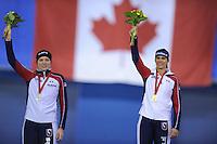 SPEEDSKATING: CALGARY: 15-11-2015, Olympic Oval, ISU World Cup, Podium 1500m Ladies, Heather Richardson (USA), winner Brittany Bowe (USA), ©foto Martin de Jong