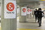 Commuters walk past a ''& TOKYO'' poster displayed in Tochomae subway station on October 16, 2015, Tokyo, Japan. Tokyo Metropolitan Government launched a new logo as a part of the Tokyo Brand Promotion Campaign with the aim of making the city the principal tourist destination in the world ahead of the Tokyo Olympic and Paralympic games in 2020. (Photo by Rodrigo Reyes Marin/AFLO)