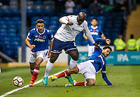 Adebayo Akinfenwa of Wycombe Wanderers is tackled by Danny Rose of Portsmouth during the FA Cup 1st round match between Portsmouth and Wycombe Wanderers at Fratton Park, Portsmouth, England on the 5th November 2016. Photo by Liam McAvoy.