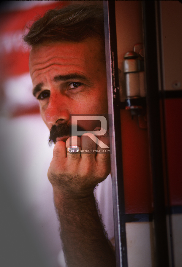 the late, great Jim Kropfeld, driver of the Miss Budweiser, looking over the pits while awaiting a qualifying run.