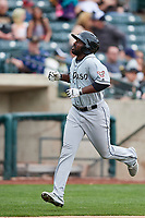 Jose Pirela (12) of the El Paso Chihuahuas scores against the Salt Lake Bees in Pacific Coast League action at Smith's Ballpark on April 30, 2017 in Salt Lake City, Utah.   El Paso defeated Salt Lake 12-3. This was Game 2 of a double-header originally scheduled on April 28, 2017.(Stephen Smith/Four Seam Images)