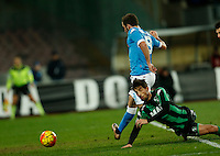 Napoli's Gonzalo Higuain shoots and scores during the  italian serie a soccer match,between SSC Napoli and Sassuolo    at  the San  Paolo   stadium in Naples  Italy , January 17, 2016