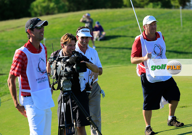 Gonzalo Fernandez-Castano (ESP) shares a joke with cameraman at the 15th green during Thursday's Round 1 of the 2013 Portugal Masters held at the Oceanico Victoria Golf Club. 10th October 2013.<br /> Picture: Eoin Clarke www.golffile.ie