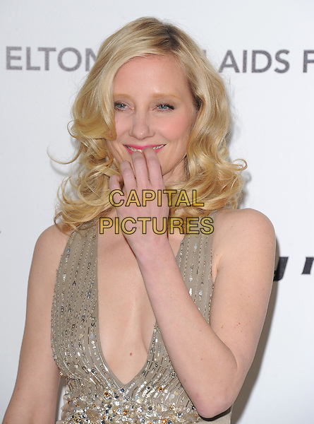 ANNE HECHE.19th Annual Elton John AIDS Foundation Academy Awards Viewing Party held at The Pacific Design Center, West Hollywood, California, USA..February 27th, 2011.half length smiling hand gold dress sequins sequined low cut neckline cleavage pink lipstick smiling.CAP/RKE/DVS.©DVS/RockinExposures/Capital Pictures.