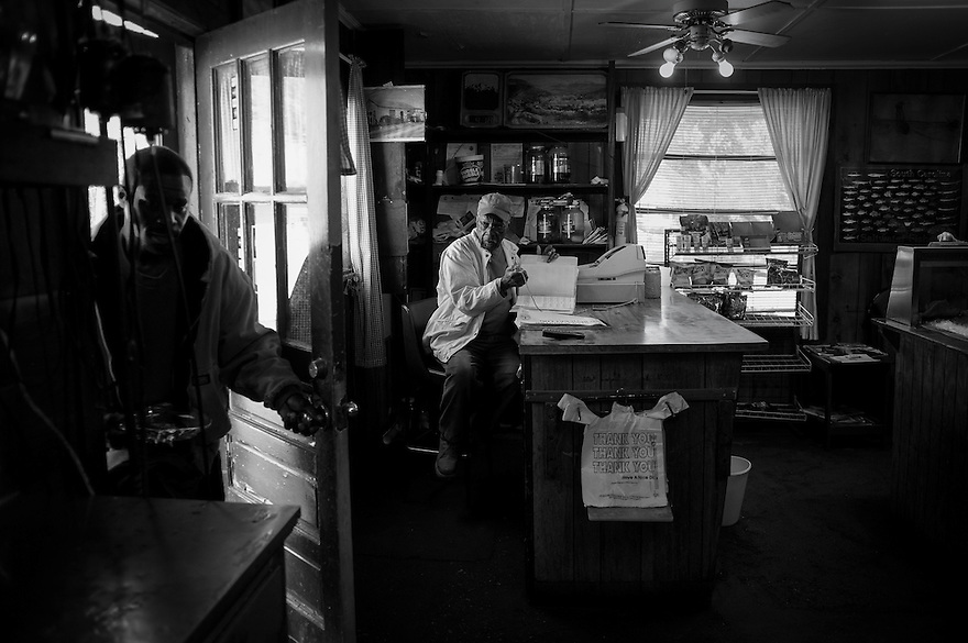 Owner Thomas Backman does paperwork in his seafood store in the community of Sol Legare on James Island near Charleston SC.