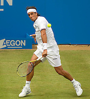 Feliciano Lopez (ESP) against Grigor Dimitrov (BUL) in the second round of the men's singles. Feliciano Lopez beat Grigor Dimitrov 6-2 6-4..Tennis - ATP World Tour - AEGON Championships - Queen's Club - London - Day 3 - Wed 09 Jun 2010..© AMN Images - Level 1, Barry House, 20-22 Worple Road, London, SW19 4DH.Tel - +44 (0) 208 947 0100.email - mfrey@advantagemedianet.com. www.photoshelter.com/c/amnimages.