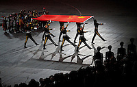 Aug. 8, 2008; Beijing, CHINA; Chinese soldiers present the China flag during the opening ceremonies for the 2008 Beijing Olympic Games at the National Stadium. Mandatory Credit: Mark J. Rebilas-