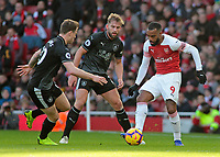 Arsenal's Alexandre Lacazette is chased down by Burnley's Ashley Barnes (left) & Charlie Taylor<br /> <br /> Photographer David Shipman/CameraSport<br /> <br /> The Premier League - Arsenal v Burnley - Saturday 22nd December 2018 - The Emirates - London<br /> <br /> World Copyright © 2018 CameraSport. All rights reserved. 43 Linden Ave. Countesthorpe. Leicester. England. LE8 5PG - Tel: +44 (0) 116 277 4147 - admin@camerasport.com - www.camerasport.com