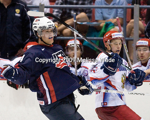 Zach Budish (US - 24), Maxim Chudinov (Russia - 27). - Team Russia defeated Team USA 6-4 in their third game in the 1980/Herb Brooks (international-size) Rink on Friday, August 14, 2009, during the 2009 USA Hockey National Junior Evaluation Camp in Lake Placid, New York.