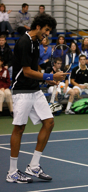 UK sophomore Panav Jha celebrates after a play against Tulsa on 1/28/12 at the Hilary J. Boone Tennis Center in Lexington, Ky. Photo by Quianna Lige | Staff
