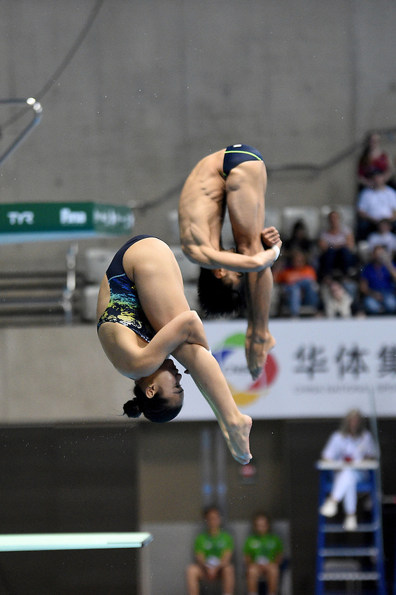 Malaysia's Muhammad Syafiq Puteh and Nur Dhabitah Syafiq Sabri compete in the mixed 3m synchro springboard <br /> <br /> Photographer Hannah Fountain/CameraSport<br /> <br /> FINA/CNSG Diving World Series 2019 - Day 3 - Sunday 19th May 2019 - London Aquatics Centre - Queen Elizabeth Olympic Park - London<br /> <br /> World Copyright © 2019 CameraSport. All rights reserved. 43 Linden Ave. Countesthorpe. Leicester. England. LE8 5PG - Tel: +44 (0) 116 277 4147 - admin@camerasport.com - www.camerasport.com