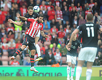 Burnley's James Tarkowski under pressure from Southampton's Charlie Austin<br /> <br /> Photographer Kevin Barnes/CameraSport<br /> <br /> The Premier League - Southampton v Burnley - Sunday August 12th 2018 - St Mary's Stadium - Southampton<br /> <br /> World Copyright &copy; 2018 CameraSport. All rights reserved. 43 Linden Ave. Countesthorpe. Leicester. England. LE8 5PG - Tel: +44 (0) 116 277 4147 - admin@camerasport.com - www.camerasport.com