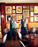 BERMUDA, Elbow Beach Resort, portrait of bartenders standing in Veranda Bar