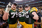 Green Bay Packers offensive linemen Bryan Bulaga (75), Nick McDonald (67) and T.J. Lang (70) celebrate after beating the Pittsburgh Steelers during Super Bowl XLV on Sunday, February 6, 2011, in Arlington, Texas. The Packers won 31-25. (AP Photo/David Stluka)
