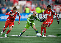 Freddie Ljungberg (10) from the Seattle Sounders FC battles for a ball with Carl Robinson (33) and Amado Guevara (20) from Toronto FC during MLS action against Seattle at BMO Field in Toronto on April 4, 2009.Seattle won 2-0. Photo by Nick Turchiaro/isiphotos.com.