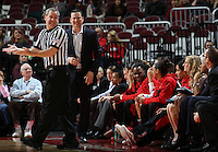 The referee gestures in a strange way while Ohio State Buckeyes coach Kevin McGuff disagrees with his call in the first half of their game against the Illinois Fighting Illini at the Value City Arena in Columbus, Ohio on January 30, 2014. (Columbus Dispatch photo by Brooke LaValley)