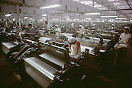 October 1984. Near Shanghai, this is the number 9 cotton factory in Shanghai, which is the biggest factory of the area. They have 10.200 workers, they are producing raw cotton material which will be dyed and distributed to the various clothes factories around the country.