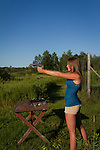 Young woman shooting a Springfield 1911 .45 ACP
